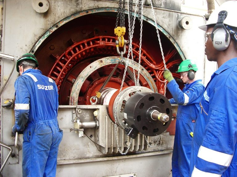 Reinstalling the rotor as the project draws to a close